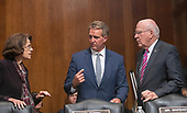 United States Senator Jeff Flake (Republican of Arizona), center, converses with United States Senator Dianne Feinstein (Democrat of California), left, and United States Senator Patrick Leahy (Democrat of Vermont), right, prior to the vote in the US Senate Committee on the Judiciary on the nomination of Judge Brett Kavanaugh to be Associate Justice of the US Supreme Court to replace the retiring Justice Anthony Kennedy on Capitol Hill in Washington, DC on Friday, September 28, 2018.  The committee voted to send the nomination to the floor but asked for a delay of up to a week in the final vote for an FBI check.<br /> Credit: Ron Sachs / CNP<br /> (RESTRICTION: NO New York or New Jersey Newspapers or newspapers within a 75 mile radius of New York City)