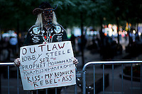 A protester holds a banner talking about Mohammad's Prophet while protesters of the Occupy Wall Street movement celebrate their first anniversary with marches and confrontations with the New York police where 150 protesters have been arrested during weekend celebrations in Manhattan.  Photo by Eduardo Munoz Alvarez / VIEWpress.