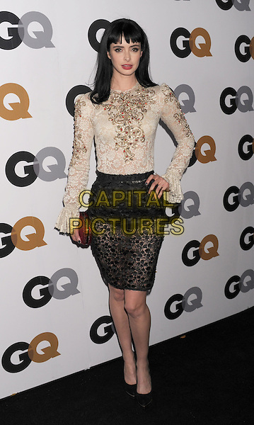 Krysten Ritter.Arriving at the GQ Men Of The Year Party at Chateau Marmont Hotel in Los Angeles, California, USA..November 13th, 2012.full length white cream lace embellished jewel encrusted top long sleeves black skirt hand on hip red clutch bag.CAP/ROT/TM.©Tony Michaels/Roth Stock/Capital Pictures