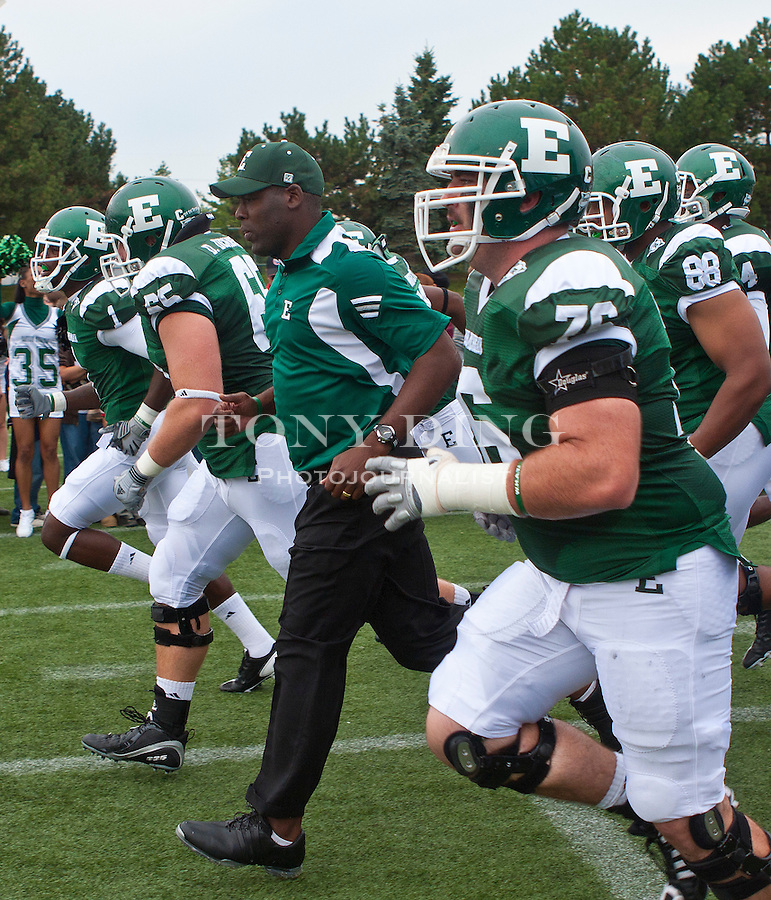 Eastern Michigan head coach Ron English, center, leads his players on the field before the first quarter of an NCAA college football game, Saturday, Sept. 18, 2010, in Ypsilanti, Mich. (AP Photo/Tony Ding)
