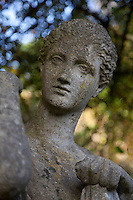 A weathered classical statue in the garden