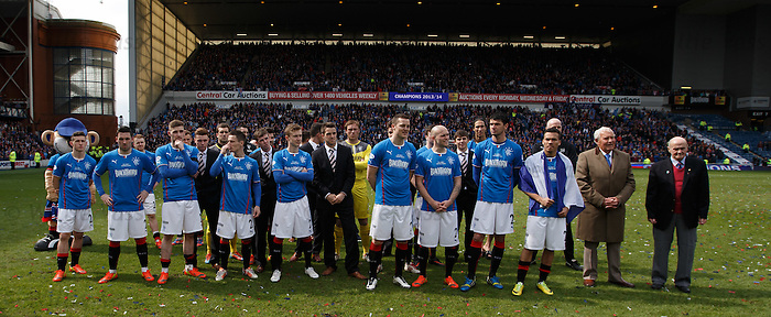 Rangers players listen at manager Ally McCoist's speech on the park