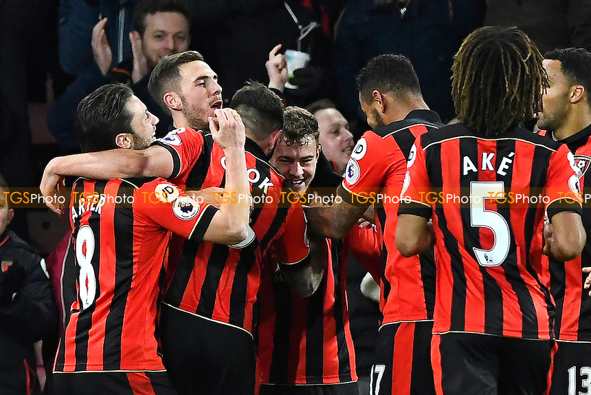Ryan Fraser of AFC Bournemouth middle is mobbed after scoring the third goal during AFC Bournemouth vs Arsenal, Premier League Football at the Vitality Stadium on 3rd January 2017