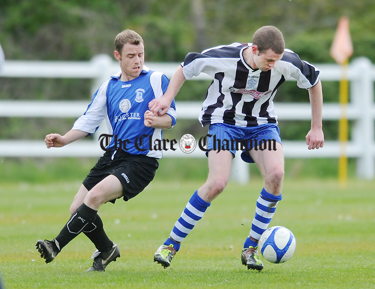 Tulla's Martin Flood turns from the challenge of Francis Franks. Photograph by Declan Monaghan