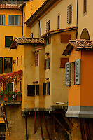 A close up of small part of the Ponte Vecchio bridge demonstrates the beautiful Florentine architecture.
