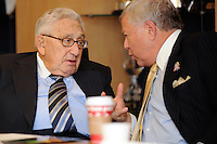Former U.S. Secretary of State Dr. Henry Kissinger talks with New England Revolution and New England Patriots owner Robert Kraft during a meeting of the Board Members of the USA Bid Committee for the FIFA World Cup in New York, NY on December 15, 2009. Handout photo courtesy USA Bid Committee.