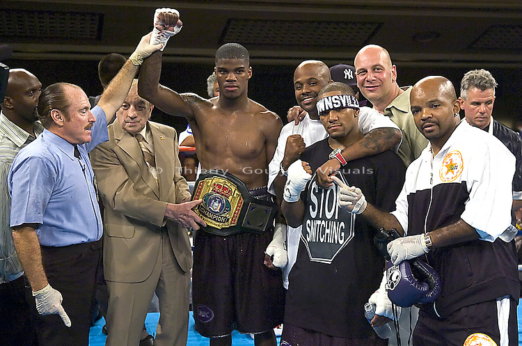 Jaidon Codrington (L) celebrates with his team after his New York State Super Middleweight Title 10 round fight against Levan Easley at the Hammerstein Ballroom in Manhattan, New York, on August 04, 2005..Codrington won the belt by 5th round TKO.