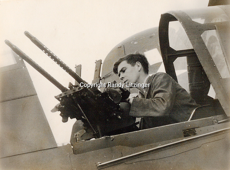 H. Staples with M1919 Browning twin 30 caliber machine guns in rear cockpit of a Curtiss SB2C-4 Helldiver from VB-85 (Bombing Squadron 85) aboard the U.S.S. Shangri-La.  - 1944 or 1945  -- Photo by Wade Litzinger