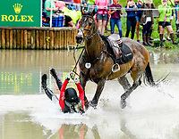 LEXINGTON, KENTUCKY - APRIL 29: Irish Rhythm #40, with rider Rachel McDonough (CAN), fail to navigate an obstacle at the Head of the Lake during the Cross Country Test at the Rolex Kentucky 3-Day Event at the Kentucky Horse Park on April 29, 2017 in Lexington, Kentucky. (Photo by Scott Serio/Eclipse Sportswire/Getty Images)