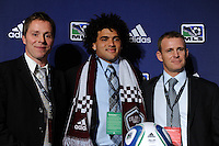 Colorado Rapids assistant coach Steve Guppy (L), second round pick Andre Akpan (Harvard University), and  head coach Gary Smith during the MLS SuperDraft at the Pennsylvania Convention Center in Philadelphia, PA, on January 14, 2010.