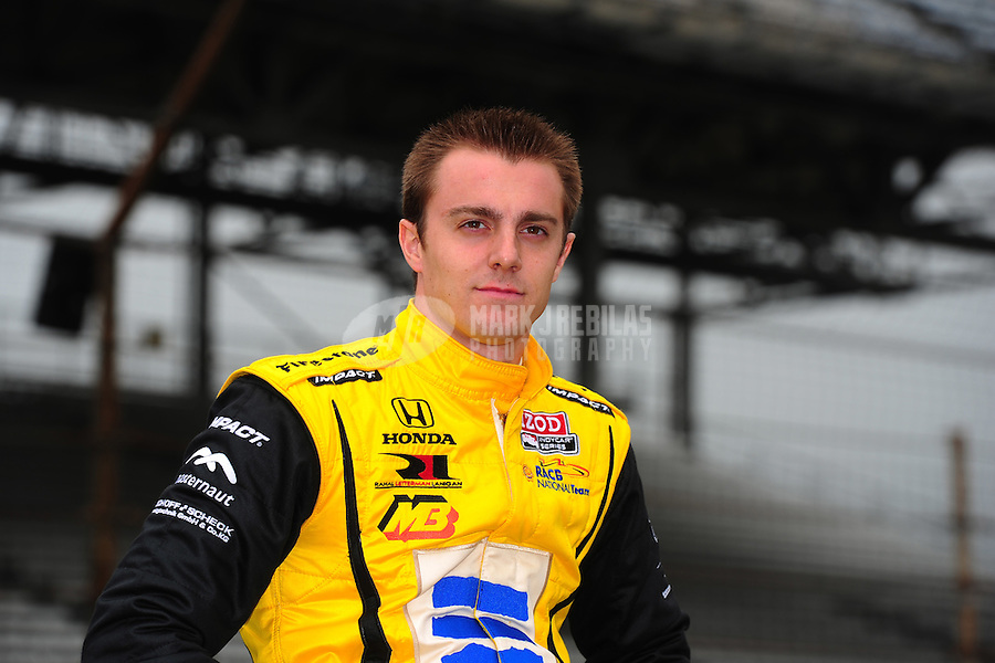 May 18, 2011; Indianapolis, IN, USA; Indy Car Series driver Bertrand Baguette during a rain delay to practice for the Indy 500 at the Indianapolis Motor Speedway. Mandatory Credit: Mark J. Rebilas-