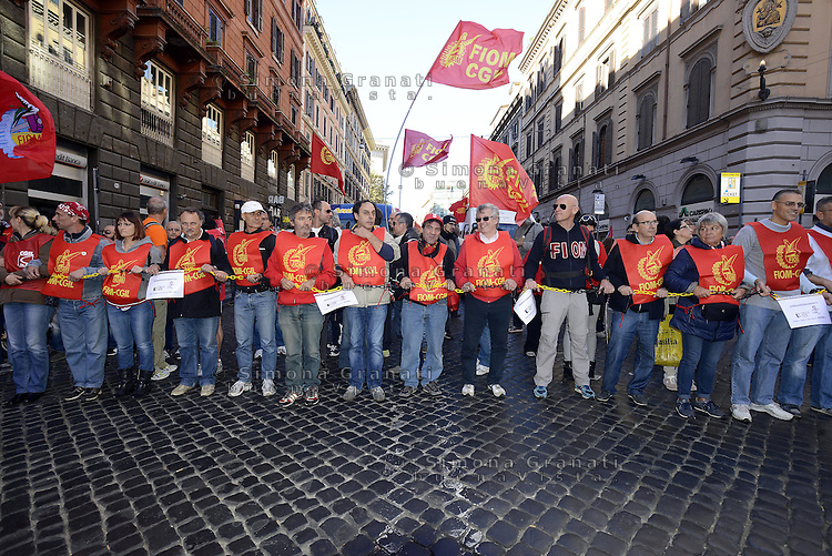 Roma, 25 Ottobre 2014<br /> Lavoro. La CGIL manifesta a Roma con due cortei nazionali fino a Piazza San Giovanni , contro il jobs act e la riforma dell'art.18 del governo Renzi.<br /> FIOM<br /> CGIL protest against the jobs act and the reform of article 18 of the government Renzi.<br /> <br /> Rome, October 25, 2014 <br /> Work. The national union CGIL manifested in Rome with two national marches to Piazza San Giovanni, against the jobs act and the reform of article 18 of the government Renzi.