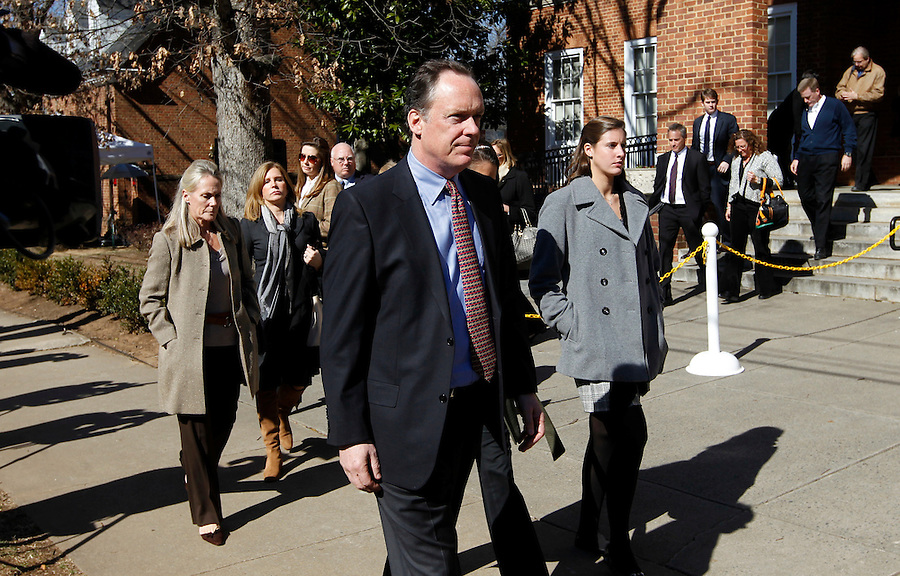 CHARLOTTESVILLE, VA - FEBRUARY 15: Family members for George Huguely walk outside the Charlottesville Circuit courthouse for the George Huguely trial. Huguely was charged in the May 2010 death of his girlfriend Yeardley Love. She was a member of the Virginia women's lacrosse team. Huguely pleaded not guilty to first-degree murder. (Credit Image: © Andrew Shurtleff