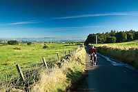 A cyclist cycling above Barrhead and Neilston, East Renfrewshire