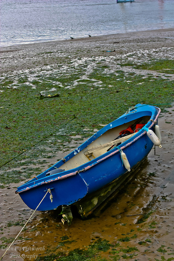 An Irish boat sits high and dry at low tide.