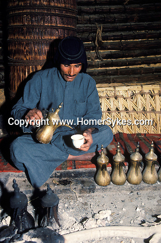 Marsh Arabs. Southern Iraq. Circa 1985. Marsh Arab man pouring coffee. Haur al Mamar or Haur al-Hamar marsh collectively known now as Hammar marshes Irag 1984