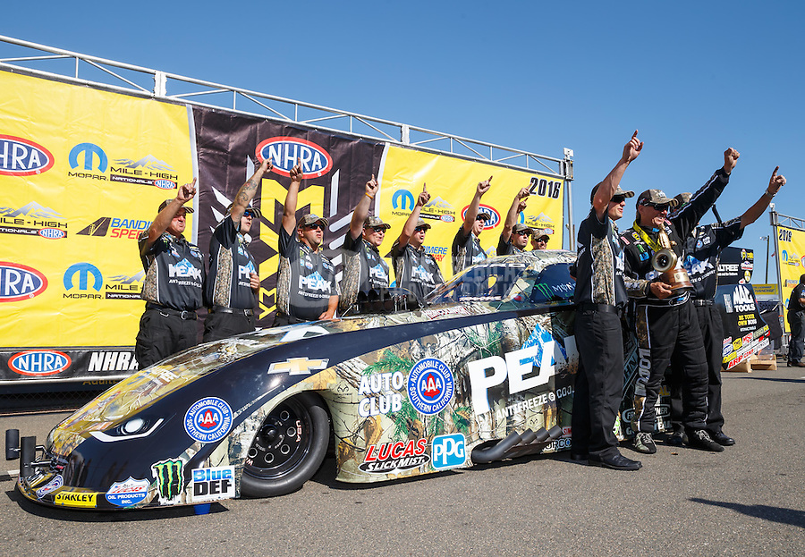 Jul 24, 2016; Morrison, CO, USA; NHRA funny car driver John Force celebrates with his crew after winning the Mile High Nationals at Bandimere Speedway. Mandatory Credit: Mark J. Rebilas-USA TODAY Sports