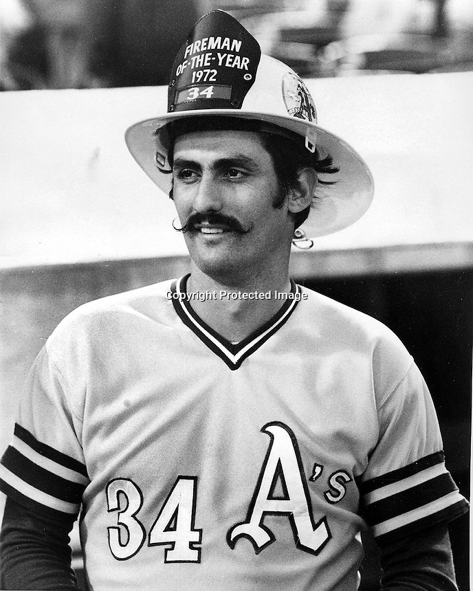 "Oakland Athletics relief pitcher Rollie Fingers get award from ""The California Fire Prevention Committee"" as the Fireman of the Year. (1972 photo by Ron Riesterer)"
