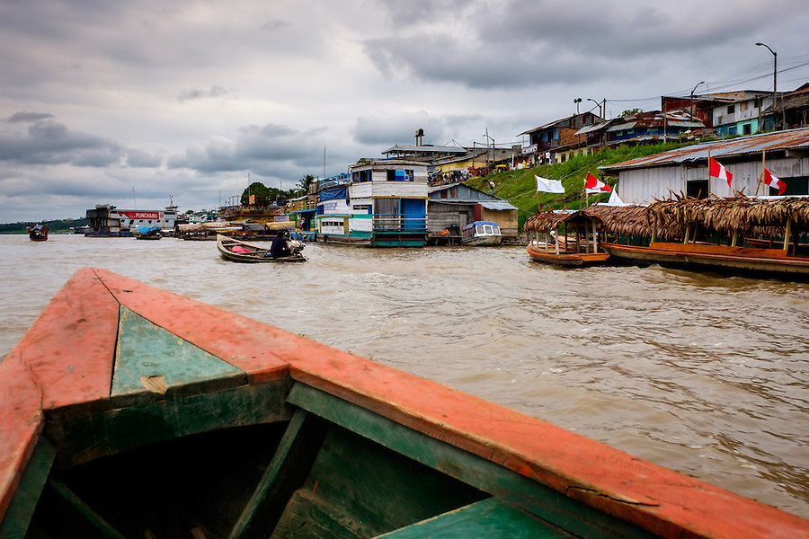 NAUTA, PERU - CIRCA OCTOBER 2015:  Boat approaching the port of Nauta in the Peruvian Amazon.