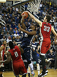 UNLV's Stephen Zimmerman Jr. blocks a shot by Nevada's D.J. Fenner during a men's college basketball game in Reno, Nev., on Saturday, Jan. 23, 2016. Cathleen Allison/Las Vegas Review-Journal