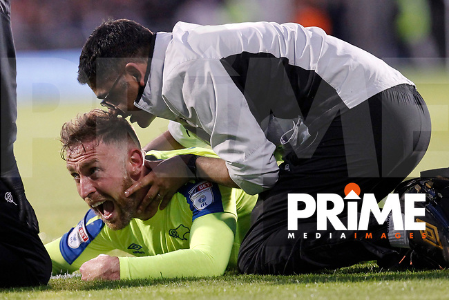 Richard Keogh of Derby County is treated for a jaw injury during the Sky Bet Championship play off semi final 2nd leg match between Fulham and Derby County at Craven Cottage, London, England on 15 May 2018. Photo by Carlton Myrie / PRiME Media Images.
