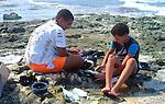 Boys gutting fish, Cayman Brac, Cayman Islands, British West Indies,