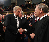 US President Donald J. Trump (L) shakes hands with Chief Justice John Roberts (R) as he arrives to deliver his first address to a joint session of Congress from the floor of the House of Representatives in Washington, DC, USA, 28 February 2017.  Traditionally the first address to a joint session of Congress by a newly-elected president is not referred to as a State of the Union.