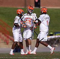 Brian Carroll (36) celebrates a goal with Virginia teammates Shamel Bratton (1) and Rhamel Bratton (3) during the ACC men's lacrosse tournament finals in College Park, MD.  Virginia defeated Maryland, 10-6.
