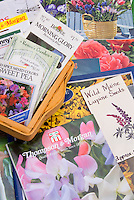 Planting seeds in winter, showing a variety of seed packets from seed companies, plant and garden catalogues