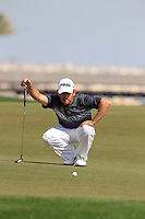 Louis Oosthuizen (RSA) lines up his putt on the par3 13th green during Friday's Round 3 of the Commercial Bank Qatar Masters 2013 at Doha Golf Club, Doha, Qatar 25th January 2013 .Photo Eoin Clarke/www.golffile.ie