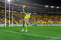 A boundary umpire throws the ball in during the ANZAC Day AFL match between St Kilda Saints and Brisbane Lions at Westpac Stadium, Wellington, New Zealand on Friday, 25 April 2014. Photo: Dave Lintott / lintottphoto.co.nz
