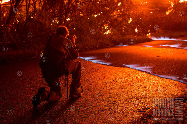 May 2018: A photographer takes images of methane gas emitting from cracks in the ground caused by the Kilauea Volcano eruption in Leilani Estates, Puna, Big Island of Hawai'i.