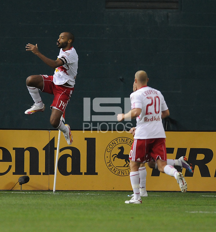New Red Bulls forward Thierry Henry (14) celebrates his score in the 12th minute of the game.  The New York Red Bulls defeated DC United 4-0, at RFK Stadium, Thursday April 21, 2011.