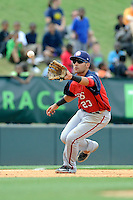 Third baseman Austin Davidson (23) of the Hagerstown Suns, fields a ground ball in a game against the Greenville Drive on May 12, 2015, at Fluor Field at the West End in Greenville, South Carolina. Greenville won, 4-0. (Tom Priddy/Four Seam Images)