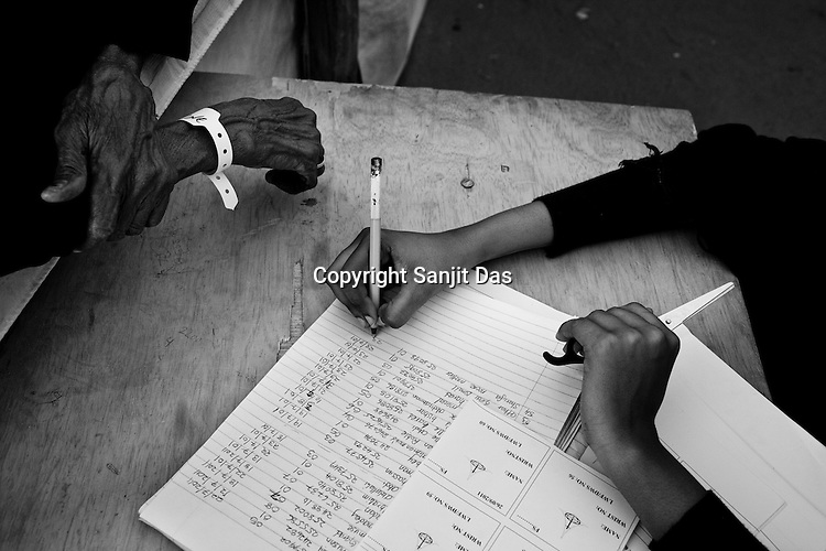 A government employee register refugees inside the food distribution point camp in Dagahaley refugee camp in the Dadaab, in northeastern Kenya. Hundreds of thousands of refugees are fleeing lands in Somalia due to severe drought and arriving in what has become the world's largest refugee camp. Photo: Sanjit Das/Panos