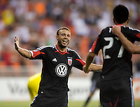 Nick DeLeon (18) of D.C. United celebrates the goal of teammate Chris Pontius (13) during the game at RFK Stadium in Washington, DC.  D.C. United defeated the Columbus Crew, 1-0.