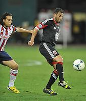 Carlos Ruiz (20) of D.C. United goes against Hector Reynoso (4) of C.D. Guadalajara. C.D.Guadalajara tied D.C. United 1-1 during and international friendly, at RFK Stadium, Friday July 12, 2013.