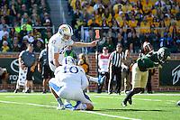 Kansas kicker Matthew Wyman (17) kicks extra point during NCAA football game, Saturday, November 01, 2014 in Waco, Tex. (Mo Khursheed/TFV Media via AP Images)