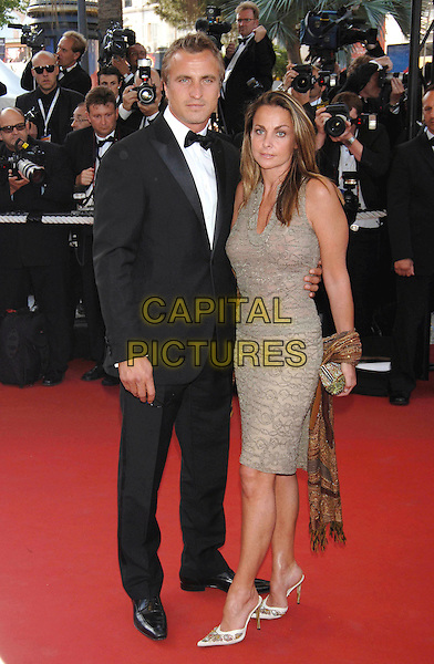 "DAVID GINOLA & WIFE.""Star Wars : Episode III - Revenge of the Sith"" screening.58th International Cannes Film Festival, France.15 May 2005.Ref: PL.premiere full length married couple husband tuxedo brown tan dress.www.capitalpictures.com.sales@capitalpictures.com.©Capital Pictures."
