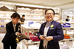 "July 27, 2018, Tokyo, Japan - Japanese Economy, Trade and Industry Minister Hiroshige Seko purchases a premium towel called as Imabari towel as he attends a promotional event of the ""Premium Friday"" at the Isetan department store in Tokyo on Friday, July 27, 2018. The Premium Friday campaign promoted workers to leave office 3 p.m. in the afternoon of the last Friday of the month for the stimulation of consumption such as shopping.      (Photo by Yoshio Tsunoda/AFLO) LWX -ytd-"