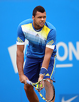 13.06.13 London, England. Jo-Wilfried Tsonga in action against Edouard Roger-Vasselin during the The Aegon Championships from the The QueenÕs Club in West Kensington.