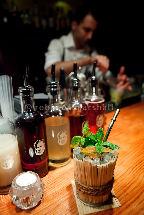 Cocktail 'Caribbean Julep' prepared by Julien Escot and served at his Papa Doble cocktail bar, Montpellier, France, 14 July 2012. Spirit bottles bear the image of Ernest Hemingway.