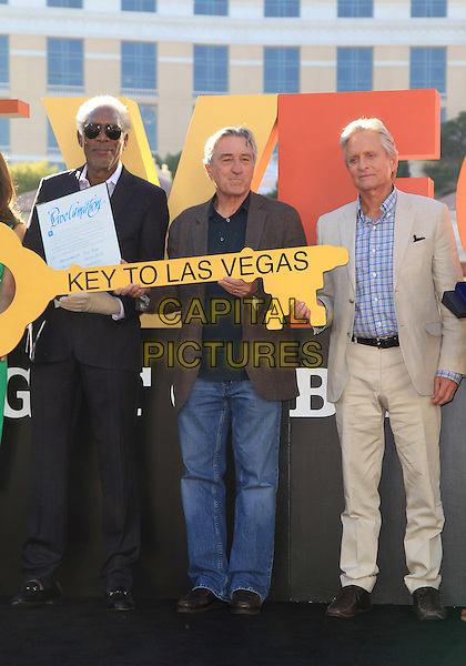 Morgan Freeman, Robert De Niro, Michael Douglas<br /> &quot;Last Vegas&quot; cast received the key to Vegas at the Bellagio Fountain, Las Vegas, NV, USA, 18th October 2013.<br /> half  length jeans beige suit shirt blue <br /> CAP/ADM/MJT<br /> &copy; MJT/AdMedia/Capital Pictures