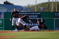 West Virginia Black Bears shortstop Cory Wood (27) tags Harrison Dinicola (24) sliding in as second baseman Dean Lockery (2) backs up the play during a NY-Penn League game against the Batavia Muckdogs on June 25, 2019 at Dwyer Stadium in Batavia, New York.  Batavia defeated West Virginia 7-3.  (Mike Janes/Four Seam Images)