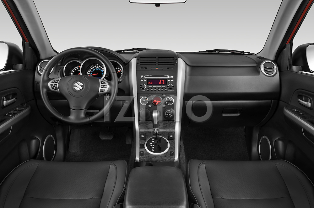 Straight dashboard view of a 2009 Suzuki Grand Vitara.