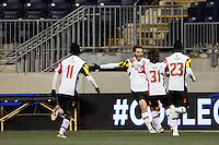 Maryland Terrapins forward Patrick Mullins (15) celebrates scoring with teammates  during the first half against the Virginia Cavaliers during the semifinals of the 2013 NCAA division 1 men's soccer College Cup at PPL Park in Chester, PA, on December 13, 2013.