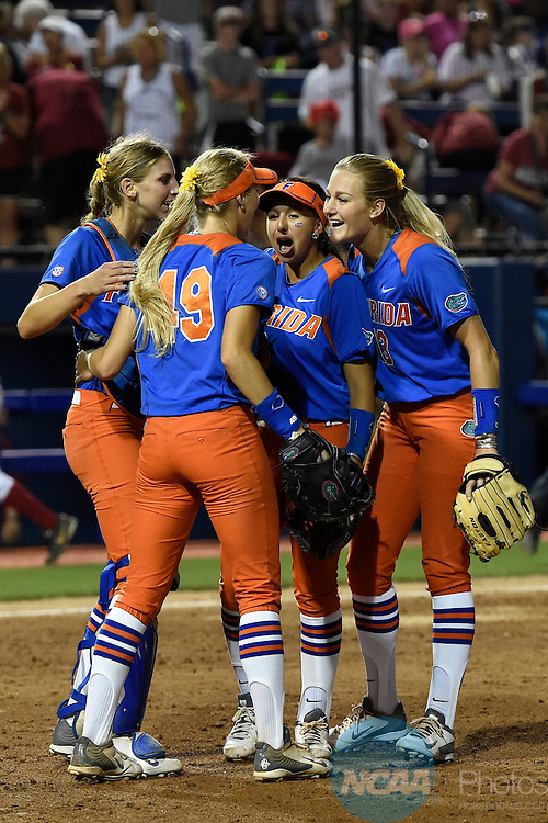 02 JUNE 2014:   The University of Florida celebrates their victory over the University of Alabama during the Division I Women's Softball Championship held at ASA Hall of Fame Stadium in Oklahoma City, OK.  Florida defeated Alabama 5-0 in Game One.  Jamie Schwaberow/NCAA Photos