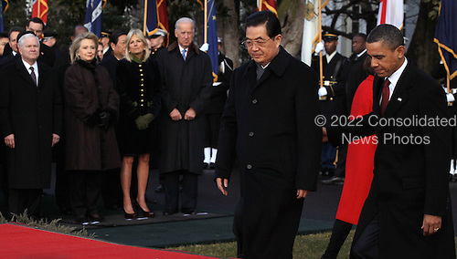 United States President Barack Obama (R) escorts President Hu Jintao of China (C) to the White House during a State arrival ceremony Wednesday, January 19, 2011 in Washington, DC. Obama and Hu are schedule to meet in the Oval Office later in the day, hold a joint press conference and attend a State dinner.  Also pictured (L-R) are U.S. Defense Secretary Robert Gates, U.S. Secretary of State Hillary Clinton, Jill Biden, and U.S. Vice President Joe Biden..Credit: Mark Wilson / Pool via CNP