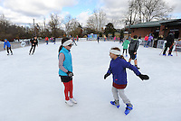 NWA Democrat-Gazette/ANDY SHUPE<br /> Friends Kate Chrisco, 10, (left) and Elliot Halford, 9, both of Bentonville, skate together Saturday, Nov. 21, 2015, during the first day of skating at the Lawrence Plaza skating rink in Bentonville. The rink is beginning its sixth year and is open daily through mid-January. Visit nwadg.com/photos to see more from the opening day.