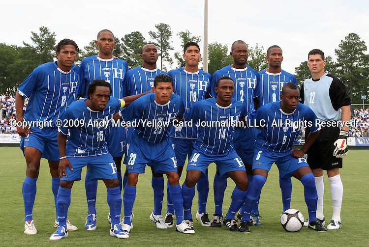 28 June 2009: Honduras' starters pose for a team photo. Front row (l to r): Walter Martinez (HON), Eder Delgado (HON), Carlos Palacios (HON), Erick Norales (HON). Back row (l to r): Carlos Costly (HON), Georgie Welcome (HON), Nery Medina (HON), Melvin Valladares (HON), Osman Chavez (HON), Allan Lalin (HON), Ricardo Canales (HON). The Honduras Men's National Team played the Panama Men's National Team at the WakeMed Stadium in Cary, North Carolina in an international friendly soccer game.